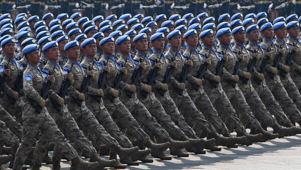 Chinese People's Liberation Army personnel participate in a military parade at Tiananmen Square in Beijing on October 1, 2019 - Sputnik France