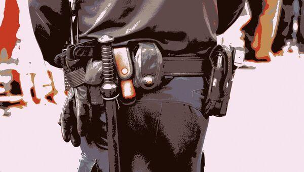 Un policier armé d'une matraque - Sputnik France