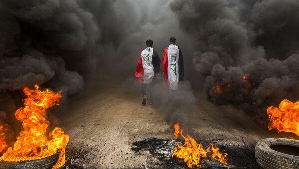 Des manifestants antigouvernementaux dans la ville irakienne de Basra, le 17 novembre 2019  (image d'archive) - Sputnik France