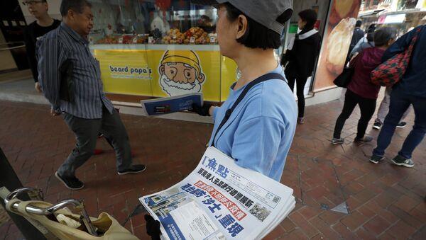 La vente des journaux avec les actualités sur la propagation du coronavirus - Sputnik France