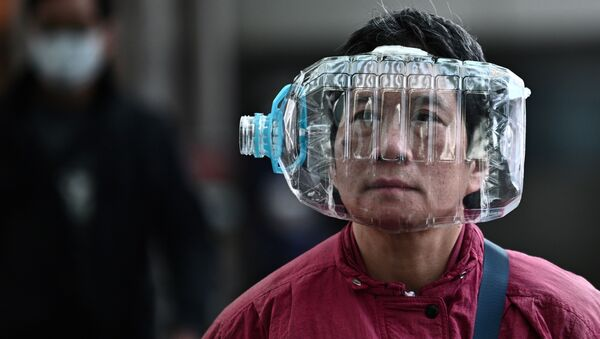 Pénurie de masques: manières originales de se protéger contre le coronavirus  - Sputnik France