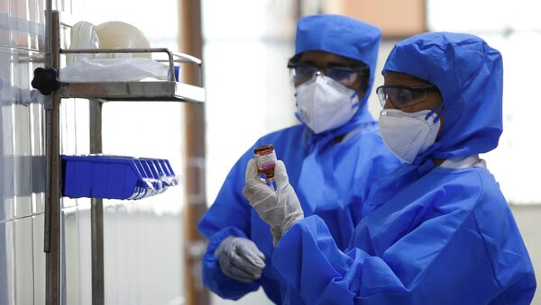 Medical staff with protective clothing are seen inside a ward specialised in receiving any person who may have been infected with coronavirus, at the Rajiv Ghandhi Government General hospital in Chennai, India, January 29, 2020. - Sputnik France