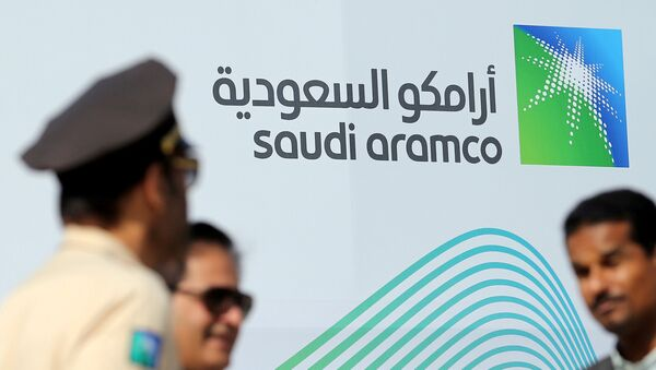The logo of Aramco is seen as security personnel stand before the start of a press conference by Aramco at the Plaza Conference Center in Dhahran, Saudi Arabia November 3, 2019 - Sputnik France