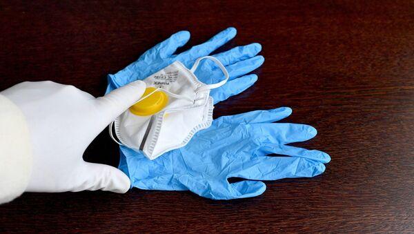 Des gants et un masque de protection - Sputnik France