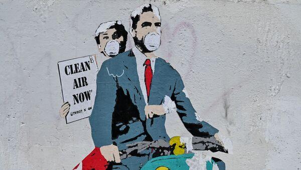 Le Covid-19 vu par les artistes: graffitis dans différentes villes du monde   - Sputnik France