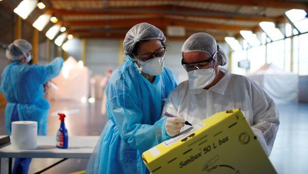 Des médecins dans la région parisienne, le 26 mars 2020 (archive photo) - Sputnik France