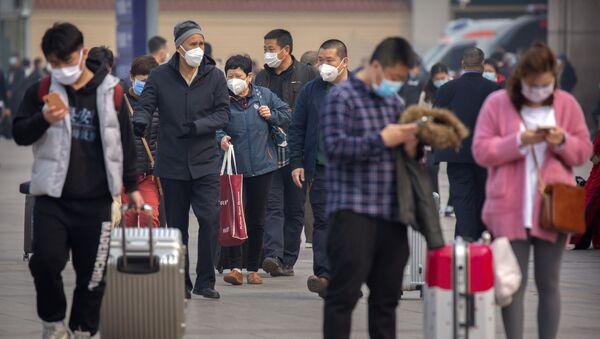 Touristes à la gare de Pékin  - Sputnik France