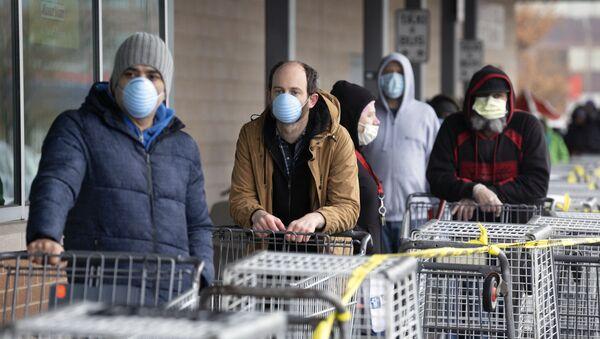 File d'attente à l'entrée du marché à Chelsea, Mass - Sputnik France