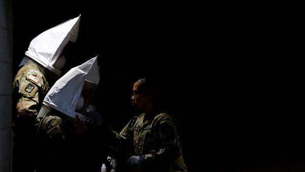 Des soldats américains en tenues de protection - Sputnik France