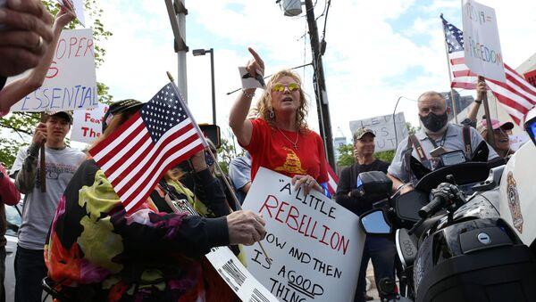 Des manifestants contre le confinement à Raleigh, en Caroline du Nord (États-Unis). - Sputnik France