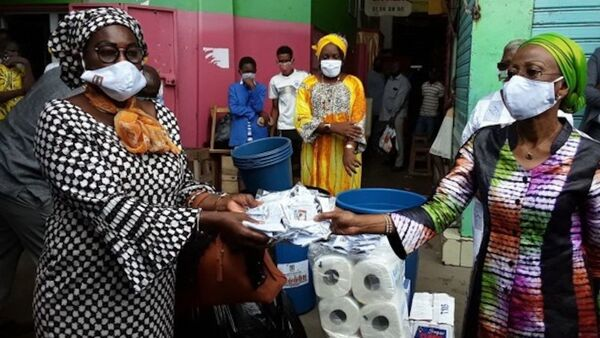 Remise de masques aux femmes du marché de Belleville, Côte d'Ivoire - Sputnik France