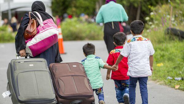 Demandeurs d'asile sur le chemin Roxham, près de la frontière américano-canadienne, 6 août 2017 - Sputnik France
