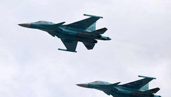 Des chasseurs-bombardiers Su-34 lors d'un défilé militaire  - Sputnik France