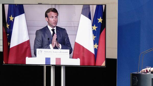 Emmanuel Macron et Angela Merkel lors d'une conférence de presse conjointe - Sputnik France
