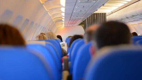 Passagers dans un avion - Sputnik France