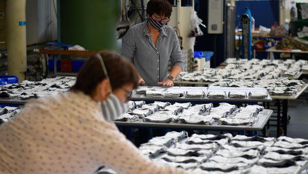Une usine de masques en tissu réutilisables  - Sputnik France