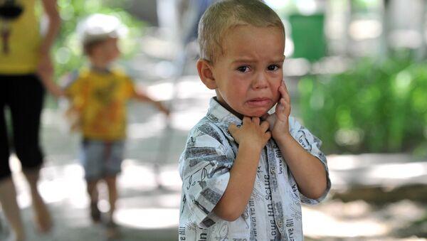 Un petit garçon-réfugié ukrainien - Sputnik France