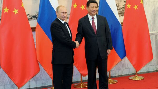 Vladimir Poutine et Xi Jinping le 9 novembre 2014 - Sputnik France