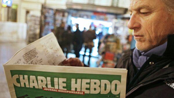 Le premier (après l'attentat ) numéro de l'hebdomadaire français satirique Charlie Hebdo - Sputnik France
